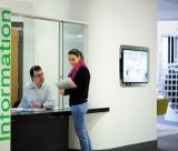 Female postgraduate student at a information desk, Medical School foyer