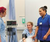 Female undergraduate student having her blood pressure checked, QMC