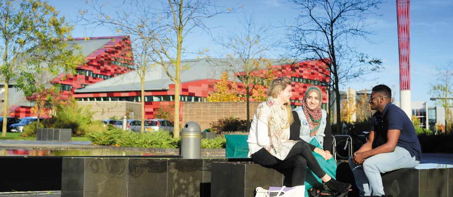 Male and female undergraduate students relaxing, Jubilee Campus