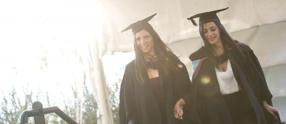 Pair of female graduates attending the 2015 winter graduation - December 2015