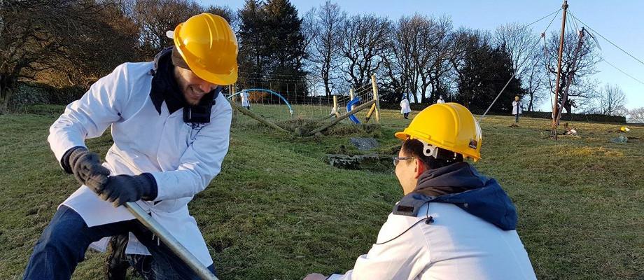 Engineering students installing wind turbine
