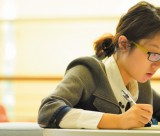 Female undergraduate student studying in a library, Ningbo campus, China