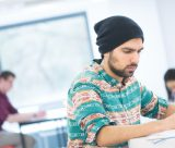 Male postgraduate student studying in the studio portland building university park