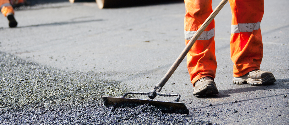 A person in safety clothing conducting road works