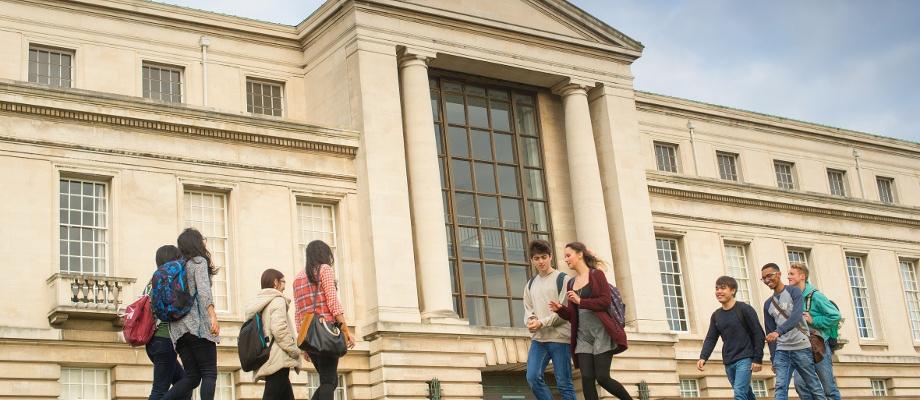 Undergraduate students walking past Portland Building